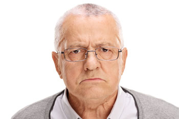 image of a grumpy older man